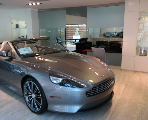 Aston Martin with glass doors in back